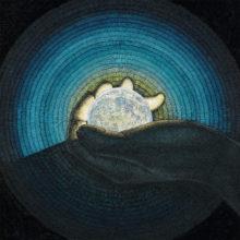 手のひらの月